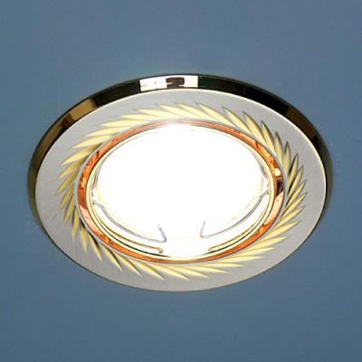 704A CX SN/G (сатин никель/золото) Электростандарт Точечный светильникКруглые<br>Лампа: MR16 G5.3 max 50 Вт Диаметр: #216; 86 мм Высота внутренней части: ? 20 мм Высота внешней части: ? 4 мм Монтажное отверстие: #216; 76 мм Гарантия: 2 года Светильник имеет поворотный механизм<br><br>S освещ. до, м2: 3<br>Тип лампы: галогенная<br>Тип цоколя: gu5.3<br>Цвет арматуры: Золотой<br>Количество ламп: 1<br>Диаметр, мм мм: 88<br>Диаметр врезного отверстия, мм: 75<br>Оттенок (цвет): сатин никель<br>MAX мощность ламп, Вт: 50