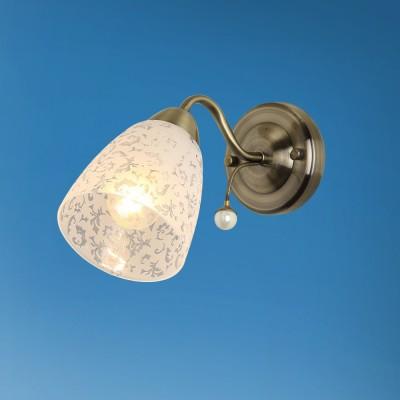 Светильник настенный бра Colosseo 72502/1W LIVIAМодерн<br><br><br>Тип лампы: Накаливания / энергосбережения / светодиодная<br>Тип цоколя: E14<br>Количество ламп: 1<br>Ширина, мм: 110<br>MAX мощность ламп, Вт: 60<br>Расстояние от стены, мм: 265<br>Высота, мм: 160<br>Цвет арматуры: бронзовый