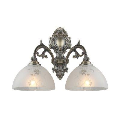 Светильник бра Colosseo 80374/2WКлассические<br><br><br>S освещ. до, м2: 8<br>Тип лампы: накаливания / энергосбережения / LED-светодиодная<br>Тип цоколя: E27<br>Количество ламп: 2<br>Ширина, мм: 390<br>MAX мощность ламп, Вт: 60<br>Расстояние от стены, мм: 230<br>Высота, мм: 330<br>Цвет арматуры: бронзовый