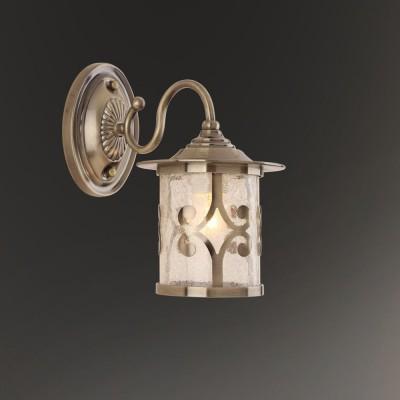 Светильник настенный бра Colosseo 82506/1W CHANTALРустика<br><br><br>Тип лампы: Накаливания / энергосбережения / светодиодная<br>Тип цоколя: E27<br>Количество ламп: 1<br>Ширина, мм: 150<br>MAX мощность ламп, Вт: 60<br>Расстояние от стены, мм: 260<br>Высота, мм: 270<br>Цвет арматуры: бронзовый