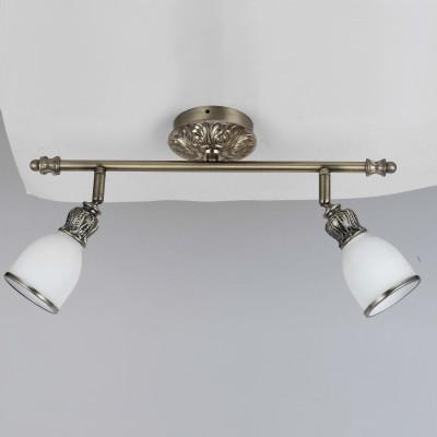 Светильник спот Lamplandia 92739 ValeryДвойные<br>Спот с литым металлическим основанием  в цвете античная латунь с плафоном из белого матового стекла.<br><br>S освещ. до, м2: 5<br>Крепление: настенный<br>Тип лампы: накал-я - энергосбер-я<br>Тип цоколя: E27<br>Количество ламп: 2<br>Ширина, мм: 120<br>MAX мощность ламп, Вт: 40<br>Длина, мм: 225<br>Высота, мм: 420<br>Цвет арматуры: серый