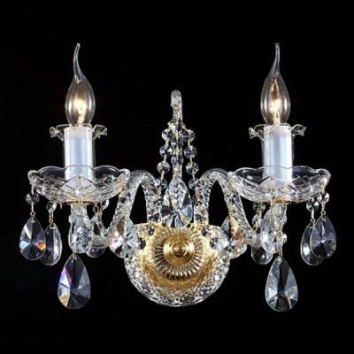 Светильник бра Maytoni DIA902-WL-02-G Monogram 2Хрустальные<br>Изысканный канделябр, разработанный дизайнерами компании Maytoni, станет украшением вашего традиционного интерьера, внеся в него свет от ламп с цоколем E14, не вошедших в стоимость хрустального бра, представленного на фото. Хрустальное бра Maytoni Diamant Crystal DIA902-WL-02-G состоит из округлого золоченого основания и двух витых ножек, несущих плафоны, внешне напоминающие горящие свечи. Изделие от Майтони декорировано прозрачным хрусталем, из которого выполнены роскошные рельефные блюдца и каплевидные подвески, мерцающие бриллиантовым светом при включении данного прибора. Приятно, что демократичная цена изделия, купить которое можно с помощью быстрого заказа в нашем магазине, отлично сочетается с высоким качеством товара, что важно при приобретении светильника для домашнего интерьера.<br><br>S освещ. до, м2: 8<br>Крепление: монтажная пластина<br>Тип лампы: накаливания / энергосбережения / LED-светодиодная<br>Тип цоколя: E14<br>Цвет арматуры: золотой<br>Количество ламп: 2<br>Ширина, мм: 370<br>Высота, мм: 240<br>MAX мощность ламп, Вт: 60