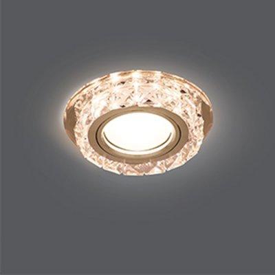 Светильник Gauss Backlight BL039 Кругл. Кристалл/Хром, Gu5.3, LED 2700KХрустальные<br>Встраиваемые светильники – популярное осветительное оборудование, которое можно использовать в качестве основного источника или в дополнение к люстре. Они позволяют создать нужную атмосферу атмосферу и привнести в интерьер уют и комфорт.   Интернет-магазин «Светодом» предлагает стильный встраиваемый светильник Gauss Backlight BL039. Данная модель достаточно универсальна, поэтому подойдет практически под любой интерьер. Перед покупкой не забудьте ознакомиться с техническими параметрами, чтобы узнать тип цоколя, площадь освещения и другие важные характеристики.   Приобрести встраиваемый светильник Gauss Backlight BL039 в нашем онлайн-магазине Вы можете либо с помощью «Корзины», либо по контактным номерам. Мы развозим заказы по Москве, Екатеринбургу и остальным российским городам.<br><br>S освещ. до, м2: 3<br>Тип лампы: галогенная/LED<br>Тип цоколя: GU5.3 (MR16)<br>Количество ламп: 1<br>MAX мощность ламп, Вт: 50<br>Диаметр, мм мм: 95<br>Диаметр врезного отверстия, мм: 65<br>Высота, мм: 35<br>Цвет арматуры: серебристый