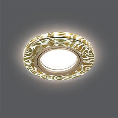 Светильник Gauss Backlight BL064 Кругл. Золотой узор/Золото, Gu5.3, LED 2700KКруглые<br>Встраиваемые светильники – популярное осветительное оборудование, которое можно использовать в качестве основного источника или в дополнение к люстре. Они позволяют создать нужную атмосферу атмосферу и привнести в интерьер уют и комфорт.   Интернет-магазин «Светодом» предлагает стильный встраиваемый светильник Gauss Backlight BL064. Данная модель достаточно универсальна, поэтому подойдет практически под любой интерьер. Перед покупкой не забудьте ознакомиться с техническими параметрами, чтобы узнать тип цоколя, площадь освещения и другие важные характеристики.   Приобрести встраиваемый светильник Gauss Backlight BL064 в нашем онлайн-магазине Вы можете либо с помощью «Корзины», либо по контактным номерам. Мы развозим заказы по Москве, Екатеринбургу и остальным российским городам.<br><br>S освещ. до, м2: 3<br>Тип лампы: галогенная/LED<br>Тип цоколя: GU5.3 (MR16)<br>Количество ламп: 1<br>MAX мощность ламп, Вт: 50<br>Диаметр, мм мм: 90<br>Диаметр врезного отверстия, мм: 65<br>Высота, мм: 25<br>Цвет арматуры: Золотой