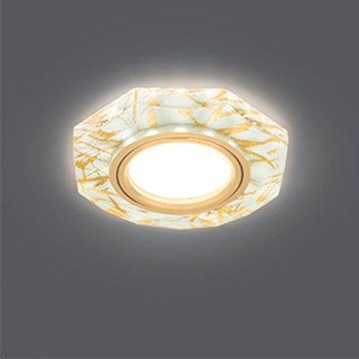 Светильник Gauss Backlight BL072 Восемь гран. Золотой узор/Золото, Gu5.3, LED 2700KКруглые<br>Встраиваемые светильники – популярное осветительное оборудование, которое можно использовать в качестве основного источника или в дополнение к люстре. Они позволяют создать нужную атмосферу атмосферу и привнести в интерьер уют и комфорт.   Интернет-магазин «Светодом» предлагает стильный встраиваемый светильник Gauss Backlight BL072. Данная модель достаточно универсальна, поэтому подойдет практически под любой интерьер. Перед покупкой не забудьте ознакомиться с техническими параметрами, чтобы узнать тип цоколя, площадь освещения и другие важные характеристики.   Приобрести встраиваемый светильник Gauss Backlight BL072 в нашем онлайн-магазине Вы можете либо с помощью «Корзины», либо по контактным номерам. Мы развозим заказы по Москве, Екатеринбургу и остальным российским городам.<br><br>S освещ. до, м2: 3<br>Тип лампы: галогенная/LED<br>Тип цоколя: GU5.3 (MR16)<br>Количество ламп: 1<br>MAX мощность ламп, Вт: 50<br>Диаметр, мм мм: 95<br>Диаметр врезного отверстия, мм: 65<br>Высота, мм: 25<br>Цвет арматуры: Золотой