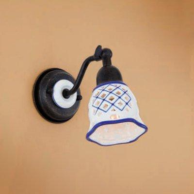 Citilux CL534511 Светильник настенный браРустика<br><br><br>S освещ. до, м2: 4<br>Тип лампы: накаливания / энергосбережения / LED-светодиодная<br>Тип цоколя: E14<br>Количество ламп: 1<br>Ширина, мм: 95<br>MAX мощность ламп, Вт: 60<br>Размеры: Ширина 9,5см, Высота 14см, Глубина 17см, Размер головки 14см, Ажурный керамическиий плафон с ручной росписью<br>Расстояние от стены, мм: 170<br>Высота, мм: 140<br>Поверхность арматуры: матовый<br>Цвет арматуры: черный