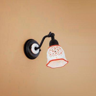 Citilux CL534513 Светильник настенный браРустика<br><br><br>S освещ. до, м2: 4<br>Тип лампы: накаливания / энергосбережения / LED-светодиодная<br>Тип цоколя: E14<br>Количество ламп: 1<br>Ширина, мм: 95<br>MAX мощность ламп, Вт: 60<br>Размеры: Ширина 9,5см, Высота 14см, Глубина 17см, Размер головки 14см, Ажурный керамическиий плафон с ручной росписью<br>Расстояние от стены, мм: 170<br>Высота, мм: 140<br>Поверхность арматуры: матовый<br>Цвет арматуры: черный