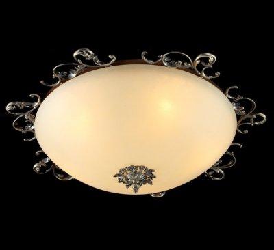 Люстра Maytoni CL900-05-R Geometry 1Потолочные<br>Если вы не можете подобрать настенно-потолочную люстру, то рекомендуем вам обратить внимание на изделие от компании Maytoni. Посмотрев на представленное фото, вы увидите светильник круглой формы кремового цвета. Этот осветительный прибор имеет пять лампочек, которые необходимо будет<br><br>Установка на натяжной потолок: Ограничено<br>S освещ. до, м2: 13<br>Крепление: Планка<br>Тип лампы: накаливания / энергосбережения / LED-светодиодная<br>Тип цоколя: E14<br>Количество ламп: 5<br>MAX мощность ламп, Вт: 40<br>Диаметр, мм мм: 640<br>Высота, мм: 200<br>Цвет арматуры: бронзовый