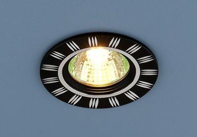 5814 черный/хром Электростандарт Точечный светильник из алюминияКруглые<br>Светильник изготовлен из литого под давления алюминия. Лаконичный строгий дизайн позволяет светильнику вписаться в любой интерьер. Лампа в светильнике фиксируется выворачивающимся диском.<br> Лампа: MR16 G5.3 max 50 Вт Диаметр: ? 78 мм Высота внутренней части: ? 22 мм Высота внешней части: ? 3 мм Монтажное отверстие: ? 65 мм Гарантия: 2 года Корпус из алюминия<br><br>Тип лампы: галогенная<br>Тип цоколя: gu5.3<br>Диаметр, мм мм: 78<br>Диаметр врезного отверстия, мм: 64