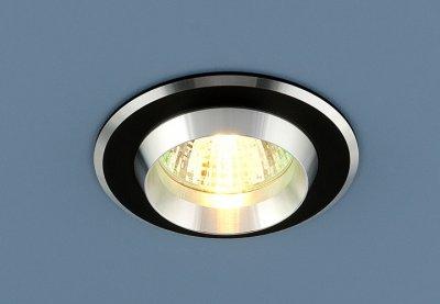 Светильник Электростандарт 5910 MR16 черный/хромметаллические встраиваемые светильники<br>Корпус светильника изготовлен из литого под давлением алюминия. Лаконичный строгий дизайн позволяет светильнику вписаться в любой интерьер. Лампа в светильнике зафиксирована выворачивающимся диском.