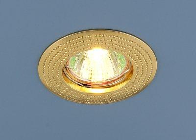 Точечный светильник золотой Электростандарт 601 G (золото)круглые точечные светильники<br>Лампа: MR16 G5.3 max 50 Вт Диаметр: ? 86 мм Высота внутренней части: ? 23 мм Высота внешней части: ? 4 мм Монтажное отверстие: ? 60 мм Гарантия: 2 года