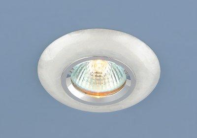 6061 белый (WH) Электростандарт Точечный светильник из искусственного камняТочечные светильники круглые<br>Декор светильника с абсолютной точностью имитирует поверхность натурального камня. В сравнении с натуральным камнем, искусственный камень намного легче и прочнее своего аналога, что позволяет устанавливать точечные светильники Elektrostandard в подвесные потолки любой сложности.<br> Лампа: MR16 G5.3 max 35 Вт Диаметр: ? 94 мм Высота внутренней части: ? 16 мм Высота внешней части: ? 12 мм Монтажное отверстие: ? 58 мм Гарантия: 2 года<br><br>Тип лампы: галогенная<br>Тип цоколя: gu5.3<br>Диаметр, мм мм: 90<br>Диаметр врезного отверстия, мм: 60<br>MAX мощность ламп, Вт: 35