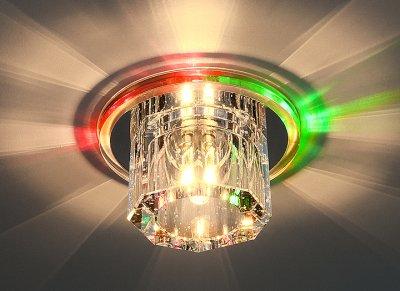 N4/A MULTI (мульти) Электростандарт Встраиваемый потолочный светильник для реечных, гипсокартонных и натяжных потолковКруглые<br>В пластиковом ободке у основания светильника установлены переливающиеся всеми цветами светодиоды. Встраиваемый светильник подходит для монтажа в гипсокартонные, реечные и натяжные потоки. Светодиоды создают необычайно красивый визуальный эффект при установке светильника на глянцевый натяжной потолок. Лампа: G4 max 50 Вт + LED Мощность LED подсветки: 1 Вт Диаметр: ? 110 мм Высота внутренней части: ? 28 мм Высота внешней части: ? 58 мм Монтажное отверстие: ? 45 мм Гарантия: 2 года<br><br>Тип лампы: галогенная<br>Тип цоколя: G4<br>Диаметр, мм мм: 112<br>Диаметр врезного отверстия, мм: 65<br>Высота, мм: 90<br>MAX мощность ламп, Вт: 50