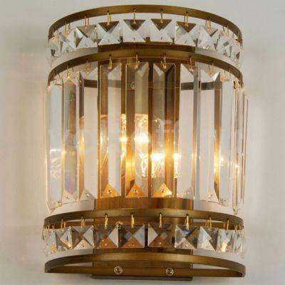 Светильник бра Favourite 1085-2wХрустальные<br><br><br>S освещ. до, м2: 6<br>Тип лампы: накаливания / энергосбережения / LED-светодиодная<br>Тип цоколя: E14<br>Количество ламп: 2<br>Ширина, мм: 200<br>MAX мощность ламп, Вт: 40<br>Диаметр, мм мм: 130<br>Размеры: W200*H250*D130<br>Расстояние от стены, мм: 130<br>Высота, мм: 250<br>Оттенок (цвет): белый<br>Цвет арматуры: бронзовый