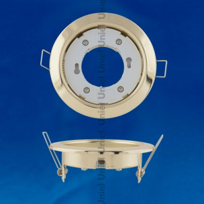 Светильник UNIEL GX53/H4 GOLDКруглые<br>Встраиваемые светильники – популярное осветительное оборудование, которое можно использовать в качестве основного источника или в дополнение к люстре. Они позволяют создать нужную атмосферу атмосферу и привнести в интерьер уют и комфорт.   Интернет-магазин «Светодом» предлагает стильный встраиваемый светильник Uniel UNIEL GX53/H4 GOLD. Данная модель достаточно универсальна, поэтому подойдет практически под любой интерьер. Перед покупкой не забудьте ознакомиться с техническими параметрами, чтобы узнать тип цоколя, площадь освещения и другие важные характеристики.   Приобрести встраиваемый светильник Uniel UNIEL GX53/H4 GOLD в нашем онлайн-магазине Вы можете либо с помощью «Корзины», либо по контактным номерам. Мы развозим заказы по Москве, Екатеринбургу и остальным российским городам.<br><br>Тип цоколя: GX53<br>Цвет арматуры: Золотой<br>Диаметр, мм мм: 106<br>Диаметр врезного отверстия, мм: 85<br>Высота, мм: 38