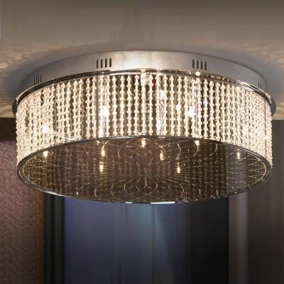 Люстра Lussole Lsa-5207-14Потолочные<br>Итальянский потолочный светильник Lussole Lsa-5207-14 станет настоящим украшением Вашего интерьера и любимым предметом в доме! В круглой «компактной» форме, выполненной из хрустальных подвесок, «спрятаны» четырнадцать галогенных лампочек. Лучи, попадая на хрусталь, отражаются во множестве граней и создают уникальное, «искристое» освещение на площади до 18 кв.м. Такая люстра должна сверкать только в больших, «парадных» помещениях, предназначенных для приема множества гостей – залах, гостиных, холлах. Она будет создавать праздничную яркую атмосферу и всегда дарить прекрасное настроение!<br><br>Установка на натяжной потолок: Да<br>S освещ. до, м2: 18<br>Крепление: Планка<br>Тип лампы: галогенная / LED-светодиодная<br>Тип цоколя: G4<br>Количество ламп: 14<br>Ширина, мм: 620мм<br>MAX мощность ламп, Вт: 20<br>Диаметр, мм мм: 620мм<br>Высота, мм: 219мм<br>Цвет арматуры: серебристый