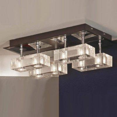 Люстра Lussole LSF-1307-08 NOTTE DI LUNAлюстры хай тек потолочные<br>Оригинальная люстра LUSSOLE LSF-1307-08 NOTTE DI LUNA выполнена в современном дизайне – восемь лампочек размещены в четыре прямоугольные секции, перекликающиеся формой с креплением. Проходя сквозь прозрачные кристаллы, свет получается ярким и направленным. Люстра идеально подойдет для установки в большом помещении, так как лампочки освещают пространство на расстоянии до двадцати двух квадратных метров!<br><br>Установка на натяжной потолок: Ограничено<br>S освещ. до, м2: 18<br>Крепление: Планка<br>Тип лампы: галогенная / LED-светодиодная<br>Тип цоколя: G9<br>Цвет арматуры: серебристый<br>Количество ламп: 8<br>Ширина, мм: 290<br>Длина, мм: 490<br>Высота, мм: 150<br>Оттенок (цвет): белый<br>MAX мощность ламп, Вт: 40