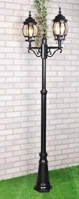 NLG99HL004 черный Электростандарт Светильник на столбеБольшие фонари<br>Мощность: 2x100 Вт Цоколь: Е27 Питание: 220-240 В / 50 Гц Защита: IP 33 Размер: 560 х 225 х 2300 мм Упаковка: 1 шт. Сегодня на рынке представлено множество садово-парковых светильников в классическом стиле. Отличительной особенностью наших светильников является не только изысканный, утонченный дизайн, но и долговечность. Корпус светильников изготовлен по специальной технологии из силумина. Силумин – это сплав алюминия и кремния. Этот металл, при небольшом весе, отличается повышенной прочностью. Легкость конструкции позволяет монтировать подвесные и настенные светильники к любым поверхностям, не опасаясь, что крепление не выдержит веса. Корпус светильника окрашивается с помощью уникальной, не имеющей на сегодняшний день аналогов, технологи. Несколько слоев краски, нанесенной с помощью порошкового напыления, делают светильник устойчивым к коррозии и к механическим воздействиям. Используя такие светильники на своем дачном участке, можно не опасаться царапин, вмятин и ржавчины на корпусе. Плафон  светильника собирается вручную. Каждая стеклянная грань надежно и плотно подогнана к корпусу светильника. Кварцевое стекло, используемое в этих светильниках, имеет высокую светопропускную способность и устойчиво к химическим и механическим воздействиям. Светильникам не страшны северные ветра и южное солнце. Диапазон рабочей температуры этих светильников от -20 до +50 градусов Цельсия. Это позволяет использовать их практически в любых регионах, с любыми погодными условиями, без ущерба для внешнего вида и без потери работоспособности.  Патрон светильников предназначен для работы с лампой с традиционным цоколем Е27, поэтому для освещения можно использовать как экономичные светодиодные лампы, так и очень модные в этом сезоне ретро-лампы Эдисона. Светильники классического дизайна не только органично дополнят любую садово-парковую зону, но и станут ярким и стильным акцентом на приусадебном участке. Изысканность л