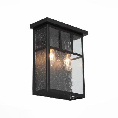 Уличный настенный светильник St luce SL079.401.02Настенные<br>Уличные светильники коллекции Glazgo выглядят просто и стильно. Они немного напоминают уютные окошечки загородного дома. Металлическое основание   окрашено в  цвет темного кофе. Плафон выполнен из кракелированного стекла, что придает ему загадочности,а рассеиваемый свет делает мягким и комфортным. Простые геометрические формы, сдержанный классический цвет делают светильник образцом элегантного вкуса.  Модель имеет высокий уровень IP защиты от влаги и пыли.<br><br>Крепление: планка<br>Тип лампы: накаливания / энергосбережения / LED-светодиодная<br>Тип цоколя: E14<br>Цвет арматуры: венге<br>Количество ламп: 2<br>Ширина, мм: 254<br>Расстояние от стены, мм: 119<br>Высота, мм: 305<br>Поверхность арматуры: матовая<br>Оттенок (цвет): коричневый<br>MAX мощность ламп, Вт: 60