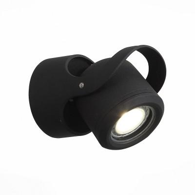 Уличный настенный светильник St luce SL093.401.01Настенные<br>Стильные миниатюрные светильники  коллекции Round украсят и дополнят обстановку экстерьера загородного дома. Их основание выполнены из металла и окрашены в два варианта цвета: серый и черный. Галогеновая лампа закрыта плафоном из прочного стекла. Точная цилиндрическая форма, идеальная для уличных светильников цветовая гамма, качественные материалы – неоспоримые достоинства этой коллекции. Помимо того, светильники имеют высокий уровень IP защиты от влаги и пыли. Они идеальны для зональной подсветки газонов, дорожек, крыльца и ступеней.<br><br>Крепление: планка<br>Цветовая t, К: 4000<br>Тип лампы: галогенная/LED<br>Тип цоколя: G5.3<br>Цвет арматуры: черный<br>Количество ламп: 1<br>Диаметр, мм мм: 90<br>Расстояние от стены, мм: 130<br>Поверхность арматуры: матовая<br>Оттенок (цвет): коричневый<br>MAX мощность ламп, Вт: 60