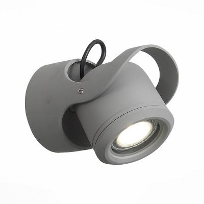 Уличный настенный светильник St luce SL093.701.01Настенные<br>Стильные миниатюрные светильники  коллекции Round украсят и дополнят обстановку экстерьера загородного дома. Их основание выполнены из металла и окрашены в два варианта цвета: серый и черный. Галогеновая лампа закрыта плафоном из прочного стекла. Точная цилиндрическая форма, идеальная для уличных светильников цветовая гамма, качественные материалы – неоспоримые достоинства этой коллекции. Помимо того, светильники имеют высокий уровень IP защиты от влаги и пыли. Они идеальны для зональной подсветки газонов, дорожек, крыльца и ступеней.<br><br>Крепление: планка<br>Цветовая t, К: 4000<br>Тип лампы: галогенная/LED<br>Тип цоколя: G5.3<br>Цвет арматуры: серый<br>Количество ламп: 1<br>Диаметр, мм мм: 90<br>Расстояние от стены, мм: 130<br>Поверхность арматуры: матовая<br>Оттенок (цвет): коричневый<br>MAX мощность ламп, Вт: 60
