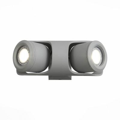 Уличный настенный светильник St luce SL093.701.02Настенные<br>Стильные миниатюрные светильники  коллекции Round украсят и дополнят обстановку экстерьера загородного дома. Их основание выполнены из металла и окрашены в два варианта цвета: серый и черный. Галогеновая лампа закрыта плафоном из прочного стекла. Точная цилиндрическая форма, идеальная для уличных светильников цветовая гамма, качественные материалы – неоспоримые достоинства этой коллекции. Помимо того, светильники имеют высокий уровень IP защиты от влаги и пыли. Они идеальны для зональной подсветки газонов, дорожек, крыльца и ступеней.<br><br>Крепление: планка<br>Цветовая t, К: 4000<br>Тип лампы: галогенная/LED<br>Тип цоколя: G5.3<br>Цвет арматуры: серый<br>Количество ламп: 2<br>Ширина, мм: 235<br>Длина, мм: 90<br>Расстояние от стены, мм: 130<br>Поверхность арматуры: матовая<br>Оттенок (цвет): коричневый<br>MAX мощность ламп, Вт: 60