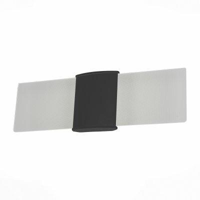 SL103.401.01 Светильник уличный настенный ST Luce Черный/Белый LED 1*6WНастенные<br>Если Вы настроены купить светильник модели SL10340101, то обратите внимание: Модели коллекции Morsetto выполнены из металла, окрашенного в глубокий чёрный или белый цвет и матового акрила. Строгая форма светильников лишь подчёркивает их совершенство. Эти модели могут быть использованы для зонального освещения коридора, прихожей, лестничной зоны, а также подсветки стен зданий на улице. Благодаря минималистическому дизайну ,светильники Morsetto будут уместны в футуристической или урбанистической обстановке.<br><br>Цветовая t, К: 3000<br>Тип лампы: LED - светодиодная<br>Тип цоколя: LED, встроенные светодиоды<br>Цвет арматуры: черный<br>Количество ламп: 2<br>Ширина, мм: 410<br>Расстояние от стены, мм: 55<br>Высота, мм: 130<br>Поверхность арматуры: матовая<br>Оттенок (цвет): черный<br>MAX мощность ламп, Вт: 3<br>Общая мощность, Вт: 6