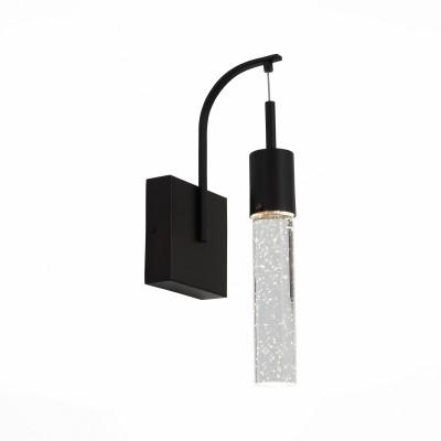 Светильник настенный St luce SL215.401.01Современные<br>Роскошная люстра коллекции Fase выполнена в современной концептуальной манере. Многочисленные подвесы, ниспадающие с круглого металлического основания цвета анодированной бронзы, производят яркое впечатление. Плафоны выполнены из рифленого или гладкого цилиндрического стекла , прозрачные  или цвета шампань . Источник света-лампы LED. Эффектный облик люстр Fase совместим с разными интерьерными решениями, от авангарда до футуризм. Эти светильники могут придать окружающей обстановке оригинальную эстетику, присущую интерьерным направлениям начала XX века и современности,  они актуальны для самых разнообразных жилых и коммерческих помещений, общественных и административных пространств.<br><br>Цветовая t, К: 4000<br>Тип лампы: LED - светодиодная<br>Тип цоколя: LED<br>Цвет арматуры: черный<br>Ширина, мм: 115<br>Расстояние от стены, мм: 140<br>Высота, мм: 480<br>MAX мощность ламп, Вт: 3