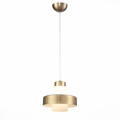 Светильник St Luce SL345.033.01одиночные подвесные светильники<br>Если Вы настроены купить светильник модели SL34503301, то обратите внимание: Вдохновением для этой элегантной и сдержанной коллекции подвесных светильников послужил колокольчик – сверкающий серебряный и насыщенный медный. Стильная цветовая гамма, простые формы, строгие металлические детали в сочетании с акриловыми плафонами будут уместны в любом интерьере: будь то хромированный минимализм или классика из натурального дерева. В коллекции три типа люстр с одиночным элементом: цилиндрический, треугольный и округлый . Особенно оригинально смотрятся люстры с шестью и более подвесами, которые включают в себя все типы форм.<br><br>Установка на натяжной потолок: Да<br>Крепление: Планка<br>Цветовая t, К: 4000<br>Тип лампы: LED<br>Тип цоколя: LED<br>Цвет арматуры: бронзовый<br>Диаметр, мм мм: 180<br>Высота полная, мм: 1200<br>Высота, мм: 400<br>Поверхность арматуры: глянцевая<br>Оттенок (цвет): бронза<br>MAX мощность ламп, Вт: 5