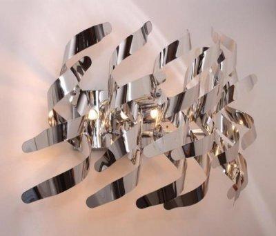 Светильник St luce SL450.001.05Бра хай тек стиля<br>Касаемо коллекции модели St luce SL450.001.05 хотелось бы отметить основные моменты: Завивающиеся металлические пластины цвета хром или алюминий, из которых собраны эти крупные дизайнерские люстры и бра, прекрасно отражают и рассеивают свет, делая светильники Scorppio акцентом современного интерьера в стиле постмодерн, лофт или хай-тек. Галогеновые лампы, спрятанные среди сверкающих хромированных завитков, обеспечат хорошее освещение зала, холла, кабинета.<br><br>S освещ. до, м2: 13<br>Крепление: планка<br>Тип лампы: галогенная / LED-светодиодная<br>Тип цоколя: G9<br>Цвет арматуры: серебристый<br>Количество ламп: 5<br>Ширина, мм: 400<br>Длина, мм: 230<br>Расстояние от стены, мм: 230<br>Высота, мм: 300<br>Поверхность арматуры: глянцевая<br>Оттенок (цвет): серебристый<br>MAX мощность ламп, Вт: 40