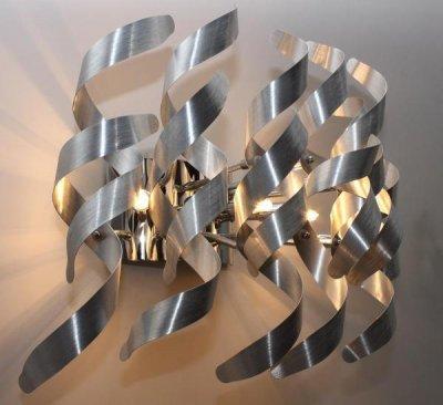 Светильник St luce SL450.101.05Хай-тек<br>Касаемо коллекции модели St luce SL450.101.05 хотелось бы отметить основные моменты: Завивающиеся металлические пластины цвета хром или алюминий, из которых собраны эти крупные дизайнерские люстры и бра, прекрасно отражают и рассеивают свет, делая светильники Scorppio акцентом современного интерьера в стиле постмодерн, лофт или хай-тек. Галогеновые лампы, спрятанные среди сверкающих хромированных завитков, обеспечат хорошее освещение зала, холла, кабинета.<br><br>S освещ. до, м2: 13<br>Крепление: планка<br>Тип лампы: галогенная / LED-светодиодная<br>Тип цоколя: G9<br>Количество ламп: 5<br>Ширина, мм: 400<br>MAX мощность ламп, Вт: 40<br>Длина, мм: 230<br>Расстояние от стены, мм: 230<br>Высота, мм: 300<br>Поверхность арматуры: глянцевая<br>Оттенок (цвет): никель<br>Цвет арматуры: серый