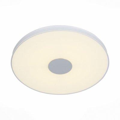 SL473.552.01 Светильник потолочный ST Luce АлюминиевыйБелый LED 1*72WОжидается<br>Если Вы настроены купить светильник модели SL47355201, то обратите внимание: Модели коллекции Semplicita относятся к классу универсальных светильников, которые можно закреплять и на стене, и на любой плоской поверхности. Основание светильников выполнено из металла цвета серебра. Стеклянный плафон мягко рассеивает свет от светодиодного источника. Люстры Semplicita гармонично впишутся в гостиную, спальню, коридор, кухню или ванную комнату , пространство которых имеет черты минималистического стиля.<br>
