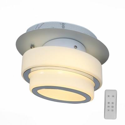 Люстра потолочная St luce SL546.501.01 OvaleПотолочные<br>Люстра коллекции Ovale -стильная композиция, которую по достоинству оценят те, кто предпочитает смелые и высокотехнологичные решения в дизайне. Конструкция представляет собой сочетание стеклянных цилиндров разного диаметра и металла, окрашенного в белый цвет. В качестве источника света в моделях Ovale используются светодиодные лампы. Потолочные светильники коллекции Ovale наполняют пространство равномерным мягким светом. Они станут акцентом в минималистический интерьере, оформленном в стиле техно или хай - тек.<br><br>Установка на натяжной потолок: Да<br>S освещ. до, м2: 4<br>Крепление: Планка<br>Тип лампы: LED - светодиодная<br>Тип цоколя: LED<br>Цвет арматуры: белый<br>Количество ламп: 1<br>Ширина, мм: 200<br>Длина, мм: 290<br>Высота, мм: 180<br>Поверхность арматуры: матовая<br>MAX мощность ламп, Вт: 12