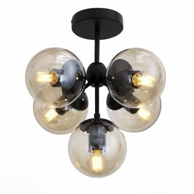 Светильник St luce SL549.402.05Потолочные<br>Если Вы настроены купить светильник модели SL54940205, то обратите внимание: Содержание важнее формы – именно так можно охарактеризовать необычную коллекцию светильников Stampo. Прозрачные стеклянные шары-плафоны начинают сверкать и переливаться, стоит только зажечь свет. Однако это не китч, а сдержанная современная стилистика, которая подчеркивает интерьер помещения, а не перекрывает его. В коллекции две вариации люстр: с тремя и пятью шарами на матовом черном каркасе . Безупречные пропорции позволяют использовать светильники в помещении любых форм и размеров – гармония дизайна уравновесит даже нестандартную геометрию.<br><br>Установка на натяжной потолок: Да<br>S освещ. до, м2: 15<br>Тип лампы: Накаливания / энергосбережения / светодиодная<br>Тип цоколя: E27<br>Количество ламп: 5<br>Диаметр, мм мм: 450<br>Высота, мм: 380<br>MAX мощность ламп, Вт: 60