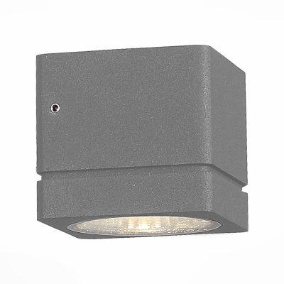 SL563.701.01 Светильник уличный настенный ST Luce Серый/Прозрачный LED 1*8WОжидается<br>Если Вы настроены купить светильник модели SL56370101, то обратите внимание: Уличные бра коллекции Coctobus -воплощение минималистической дизайн- концепции. Строгая форма светильника лишь подчеркивает его совершенство. Корпус выполнен из алюминия и окрашен в чёрный или серый цвет. Светильники имеют степень защиты IP 44 и предназначены для зонального освещения стен зданий и других архитектурных сооружений.<br>