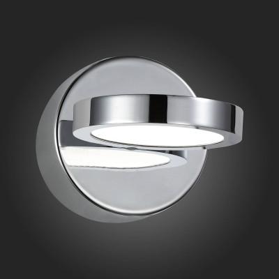 Светильник St Luce SL588.501.01Хай-тек<br>Если Вы настроены купить светильник модели SL58850101, то обратите внимание: Форма светильников Colo нарочито проста. Их можно использовать как архитектурный свет при освещении квартир, домов, коттеджей. Направление света можно регулировать за счет поворотного механизма. Бра изготовлены из металла с покрытием хром и белого акрила. Источник света – LED.<br><br>Цветовая t, К: 4000<br>Тип лампы: LED<br>Ширина, мм: 90<br>MAX мощность ламп, Вт: 4.5<br>Расстояние от стены, мм: 125<br>Высота, мм: 90<br>Цвет арматуры: серебристый