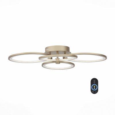 SL867.202.04 Люстра потолочная ST Luce Золото/Белый LED 4*16WОжидается<br>Если Вы настроены купить светильник модели SL86720204, то обратите внимание: Люстры из серии Twiddle - находка для ценителей современных дизайнерских инноваций в интерьере. Основание светильника выполнено из металла и представленно в пяти цветах (белый, черный, хром, золото, бронза). В качестве источника освещения используется светодиодная лента, которая декорирована полупрозрачным акрилом. Данная модель оснащена пультом, с помощью которого можно регулировать яркость и цветовую температуру свечения 3000K/4100K/6000K.<br>