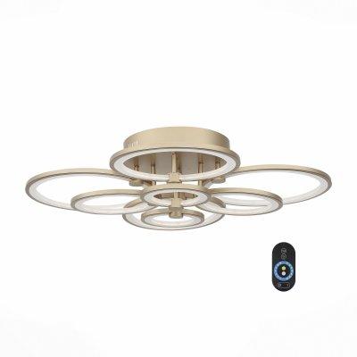 SL867.202.08 Люстра потолочная ST Luce Золото/Белый LED 8*15WОжидается<br>Если Вы настроены купить светильник модели SL86720208, то обратите внимание: Люстры из серии Twiddle - находка для ценителей современных дизайнерских инноваций в интерьере. Основание светильника выполнено из металла и представленно в пяти цветах (белый, черный, хром, золото, бронза). В качестве источника освещения используется светодиодная лента, которая декорирована полупрозрачным акрилом. Данная модель оснащена пультом, с помощью которого можно регулировать яркость и цветовую температуру свечения 3000K/4100K/6000K.<br>