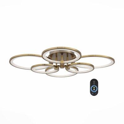 SL867.302.06 Люстра потолочная ST Luce Бронза/Белый LED 6*14WОжидается<br>Если Вы настроены купить светильник модели SL86730206, то обратите внимание: Люстры из серии Twiddle - находка для ценителей современных дизайнерских инноваций в интерьере. Основание светильника выполнено из металла и представленно в пяти цветах (белый, черный, хром, золото, бронза). В качестве источника освещения используется светодиодная лента, которая декорирована полупрозрачным акрилом. Данная модель оснащена пультом, с помощью которого можно регулировать яркость и цветовую температуру свечения 3000K/4100K/6000K.<br>