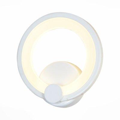 Бра St luce SL869.501.01Хай-тек<br>Если Вы настроены купить светильник модели SL86950101, то обратите внимание: Люстры коллекции Ciclo- находка для ценителей современных дизайнерских инноваций в интерьере. Основание светильника выполнено из металла с покрытием белого цвета. В качестве источника освещения используется светодиодная лента, которая декорирована полупрозрачным акрилом. Модели коллекции Ciclo гармонично впишутся в современные интерьеры индустриального стиля.<br><br>Крепление: на планку<br>Цветовая t, К: CW - холодный белый 4000 К<br>Тип лампы: LED - светодиодная<br>Тип цоколя: LED<br>Количество ламп: 1<br>MAX мощность ламп, Вт: 12<br>Диаметр, мм мм: 295<br>Выступ, мм: 60<br>Расстояние от стены, мм: 60<br>Поверхность арматуры: матовая<br>Оттенок (цвет): белый<br>Цвет арматуры: белый