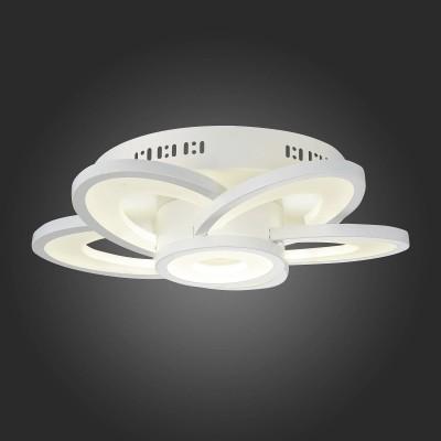 Светильник St Luce SL909.102.06Потолочные<br>Если Вы настроены купить светильник модели SL90910206, то обратите внимание: Это фантастическая коллекция, достойна центрального места в интерьере. Люстры Petalo одновременно простые и эффектные, декоративны и без излишеств, строги и футуристичны. Их свечение наполняет комнату трёхмерной глубиной, охватывая каждый миллиметр помещения. Игра форм и плоскостей придает светильникам коллекции Petalo потрясающий вид и неповторимый стиль. Массивное металлическое основание окрашенное в белый цвет надёжно удерживает акриловые кольца с металлической окантовкой. Белый цвет люстры добавляет свежести и умиротворенности интерьеру.<br><br>Установка на натяжной потолок: Да<br>S освещ. до, м2: 41<br>Цветовая t, К: 4000<br>Тип лампы: LED<br>Тип цоколя: LED<br>MAX мощность ламп, Вт: 103<br>Диаметр, мм мм: 460<br>Высота, мм: 128