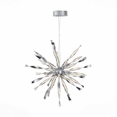 Светильник St Luce SL927.113.24Подвесные<br>Если Вы настроены купить светильник модели SL92711324, то обратите внимание: Фантазийная коллекция светильников Raggio впечатляет изяществом композиции из металла , акрила и источников LED . Загнутые в спирали разнонаправленные металлические пластины кажутся тонкими и хрупкими. Светодиоды, используемые в люстрах этой коллекции, встроены настолько изящно, что кажутся незаметными. Но, только срабатывает выключатель, как лучики света начинают играть в романтических завитках. Комната наполняется приятным мягким светом, мечтательным настроением и восторженными взглядами . Люстры коллекции Raggio становятся ярким акцентом в любом современном интерьере.<br><br>Установка на натяжной потолок: Да<br>S освещ. до, м2: 40<br>Тип лампы: LED<br>Тип цоколя: LED<br>Количество ламп: 1<br>MAX мощность ламп, Вт: 100<br>Диаметр, мм мм: 1000<br>Высота, мм: 1500<br>Общая мощность, Вт: 100
