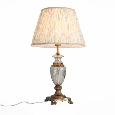 Настольная лампа St luce SL966.304.01Классические<br>Коллекция светильников Assenza-это сочетание классических плафонов с уникальными стеклянными основаниями-настоящими шедеврами стеклодувов.Прозрачный каркас светильников, попадая под направленный световой поток, создает ощущение невесомости, и кажется, что абажур парит в воздухе. Свет, отражаясь от стекла, игривыми лучами разлетается по всей комнате, наполняя ее настроением и уютом. Матовый абажур сдерживает естественную яркость лампы, приглушает свет и создает приятную приватную атмосферу.<br><br>Тип лампы: Накаливания / энергосбережения / светодиодная<br>Тип цоколя: E27<br>Цвет арматуры: бронзовый<br>Количество ламп: 1<br>Диаметр, мм мм: 400<br>Высота, мм: 580<br>MAX мощность ламп, Вт: 60