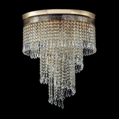 Люстра Maytoni T522-PT40x50-G CascadeКаскадные<br>Современная хрустальная люстра немецкой фирмы Майтони обладает довольно внушительными размерами. Ее диаметр составляет 420 миллиметров, а высота – 500 миллиметров. Исходя из этого, хрустальную люстру Maytoni Diamant Crystal T522-PT40x50-G лучше купить для просторного помещения с высокими потолками. Так как в люстру устанавливают семь ламп мощностью по 60 Ватт с цоколем Е14, ее освещение будет достаточно ярким для комнат больших размеров. На фото видна золотая арматура и множество расположенных по спирали хрустальных подвесок, делающих стоимость изделия довольно высокой. Однако продукцию компании Maytoni всегда отличает оптимальное соотношение цены и качества.<br><br>Установка на натяжной потолок: Да<br>S освещ. до, м2: 28<br>Крепление: Планка<br>Тип лампы: накаливания / энергосбережения / LED-светодиодная<br>Тип цоколя: E14<br>Количество ламп: 7<br>MAX мощность ламп, Вт: 60<br>Диаметр, мм мм: 420<br>Высота, мм: 500<br>Цвет арматуры: золотой