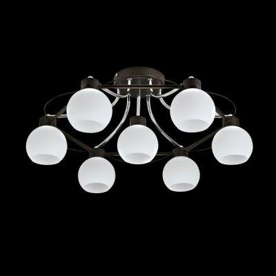 Люстра Maytoni TOC010-07-N Eurosize 10Потолочные<br>Компания Maytoni выпустила потолочную люстру, состоящую из семи плафонов. Убедиться вы этом вы можете, посмотрев на представленное фото. Каркас потолочной люстры Maytoni TOC010-07-N выполнен из металла цвета хрома и венге. Осветительный прибор относится к стилю модерн. Это невероятно красивое изделие от немецких дизайнеров фирмы Майтони станет не только источником света в вашем помещении, но и частью его декора. Также это изделие способно осветить площадь помещения до 20 квадратных метров. Купить этот прибор, в стоимость которого не входит цена семи лампочек, вы можете у нас.<br><br>Установка на натяжной потолок: Ограничено<br>S освещ. до, м2: 28<br>Крепление: Планка<br>Тип лампы: накаливания / энергосбережения / LED-светодиодная<br>Тип цоколя: E14<br>Количество ламп: 7<br>MAX мощность ламп, Вт: 60<br>Диаметр, мм мм: 605<br>Высота, мм: 245<br>Цвет арматуры: серебристый