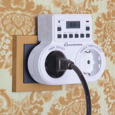 TMH-E-5 Электростандарт Розетка-таймерРозетка с таймером<br>Модель TMH-E-5 имеет две розетки, одна из которых оснащена электронным таймером, программируемым на неделю с точностью до минуты.<br>? Защита от детей ? Двойная розетка ? Встроенный аккумулятор ? Функция летнего времени ? Функция произвольного включения ? Индикатор работы розетки-таймер<br>Питание: 220 – 240 В, 50 Гц Макс. мощность нагрузки: 2 x 1800 Вт Макс. ток нагрузки: 2 x 8 А Пылевлагозащищенность: IP20 Рабочая температура: -10° ... +40° С Минимальный временной интервал: 1 мин Количество программ: 10 Каждая программа предусматривает 1 цикл включения/выключения.<br>
