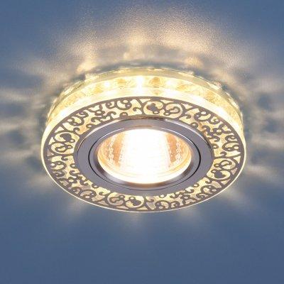 6034 MR16 CH/CL хром/прозрачный Электростандарт Точечный светодиодный светильник с хрусталемКруглые<br>Точечные светильники Elektrostandard™ предназначены для жилых и общественных помещений. Светильник подходит для всех типов подвесных потолков: гипсокартонных, натяжных и реечных. Cветильники оснащены светодиодной подсветкой, которая может быть включена как совместно с лампой, так и отдельно. Мягкий свет от светодиодов создает идеальную атмосферу для отдыха или просмотра телевизора.<br> Лампа: MR16 G5.3 max 50 Вт + LED Мощность LED подсветки: 3 Вт Диаметр: ? 96 мм Высота внутренней части: ? 15 мм Высота внешней части: ? 17 мм Монтажное отверстие: ? 60 мм Гарантия: 2 года<br><br>Тип цоколя: gu5.3<br>Диаметр, мм мм: 96<br>Диаметр врезного отверстия, мм: 60<br>Высота, мм: 17<br>MAX мощность ламп, Вт: 50