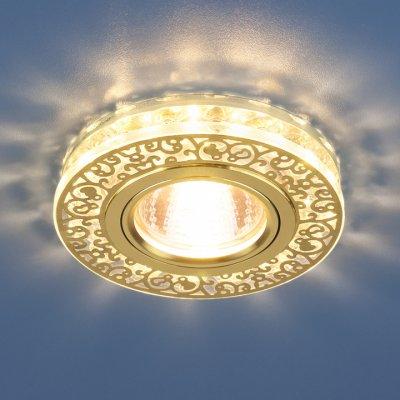 6034 MR16 GD/CL золото/прозрачный Электростандарт Точечный светодиодный светильник с хрусталемКруглые встраиваемые светильники<br>Точечные светильники Elektrostandard™ предназначены для жилых и общественных помещений. Светильник подходит для всех типов подвесных потолков: гипсокартонных, натяжных и реечных. Cветильники оснащены светодиодной подсветкой, которая может быть включена как совместно с лампой, так и отдельно. Мягкий свет от светодиодов создает идеальную атмосферу для отдыха или просмотра телевизора.<br> Лампа: MR16 G5.3 max 50 Вт + LED Мощность LED подсветки: 3 Вт Диаметр: ? 96 мм Высота внутренней части: ? 15 мм Высота внешней части: ? 17 мм Монтажное отверстие: ? 60 мм Гарантия: 2 года<br><br>Тип цоколя: gu5.3<br>Диаметр, мм мм: 96<br>Диаметр врезного отверстия, мм: 60<br>Высота, мм: 17<br>MAX мощность ламп, Вт: 50