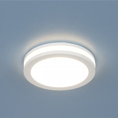 Точечный светильник со светодиодами Электростандарт DSKR80 5W 4200KСветодиодные круглые встраиваемые светильники<br>Этот светильник способен заполнить Вашу комнату ярким светом, при этом экономя Ваши средства на оплату электроэнергии. Высокая степень влагозащиты позволяет использоваться данные светильники в ванных комнатах и других помещениях с повышенной влажностью. Сдержанный дизайн данного светильника дополнен вставкой из акрила, дающего рассеянный свет, благодаря чему Ваш интерьер приобретет ультрасовременный вид, одновременно сохранив ощущение уюта.  <br> Мощность: 5 Вт LED Свет: 4200K Светоотдача: 450 лм Угол рассеивания света: 170° Питание: 220 В 50 Гц Уровень защиты: IP44 Срок службы LED: 50 000 ч Диаметр: ? 80 мм Монтажное отверстие: ? 65 мм Высота внутренней части: ? 25 мм Высота внешней части: ? 14 мм Гарантия: 2 года Корпус из алюминия