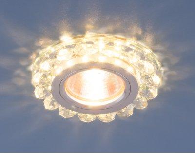 6036 MR16 СL прозрачный Электростандарт Точечный светодиодный светильник с хрусталемВстраиваемые хрустальные светильники<br>Точечные светильники Elektrostandard™ предназначены для жилых и общественных помещений. Светильник подходит для всех типов подвесных потолков: гипсокартонных, натяжных и реечных. Cветильники оснащены светодиодной подсветкой, которая может быть включена как совместно с лампой, так и отдельно. Мягкий свет от светодиодов создает идеальную атмосферу для отдыха или просмотра телевизора.<br> Лампа: MR16 G5.3 max 50 Вт + LED Мощность LED подсветки: 3 Вт Диаметр: ? 90 мм Высота внутренней части: ? 20 мм Высота внешней части: ? 15 мм Монтажное отверстие: ? 70 мм Гарантия: 2 года<br><br>Тип цоколя: gu5.3<br>Диаметр, мм мм: 90<br>Диаметр врезного отверстия, мм: 70<br>Высота, мм: 15<br>MAX мощность ламп, Вт: 50
